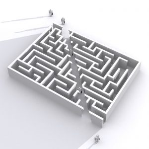 Maze with a shortcut through the middle. People are walking through the shortcut