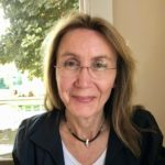Straight-on photo of Heather looking very happy.