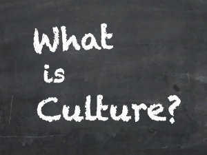 "The question ""What is Culture?"" written in chalk on a blackboard."